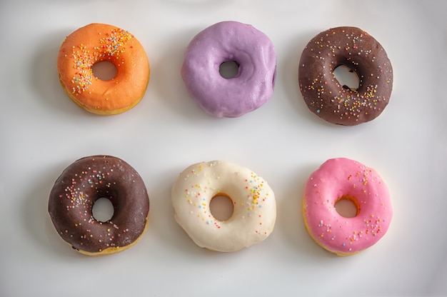 Close up on multicolor of donuts
