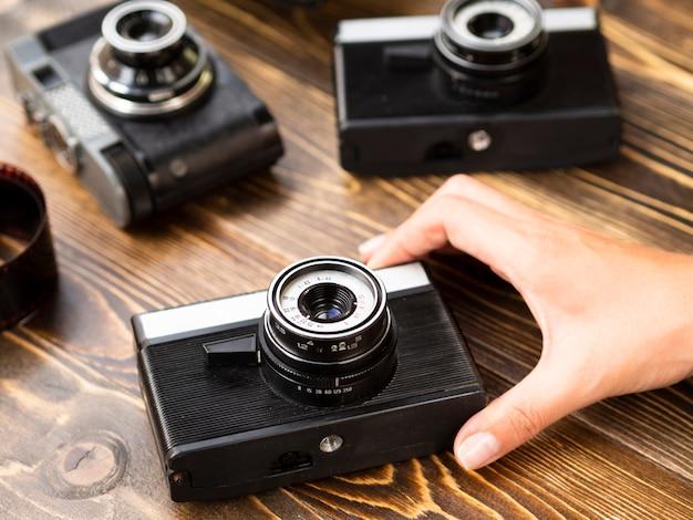 Close-up of multiple retro photo cameras