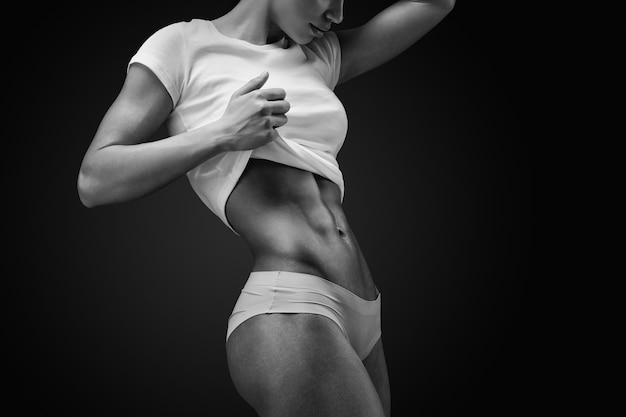 Close-up of muscular abdomen of female model