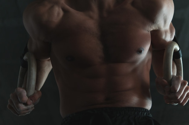 Close up of a muscular young athlete's core