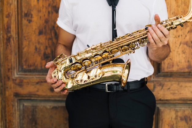 Close up musician holding the sax