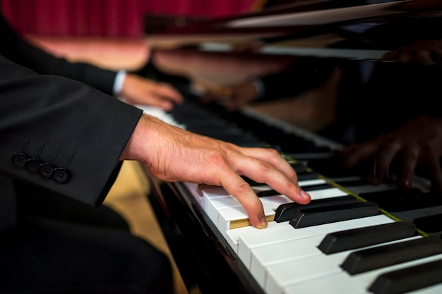 Close-up musician playing piano