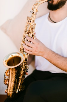 Close up musician playing saxophone