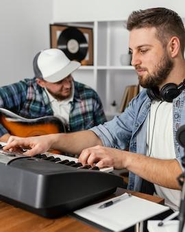 Close-up musicians composing music