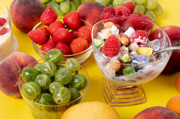 Close up musli yogurt with fresh fruits arrangement