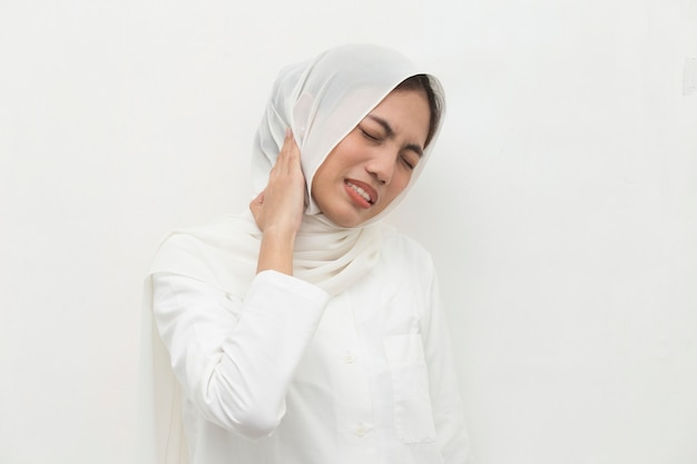 Close up muslim woman neck and shoulder pain and injury medical concept