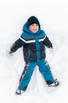 Close up n happy kid playing in the snow