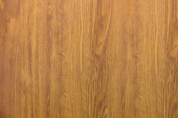 Close-up of natural new soft yellow golden brown wooden surface, parquet, planks or boards.