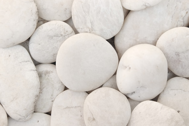 Close up natural white pebbles, texture of decorative stone gravel for background.
