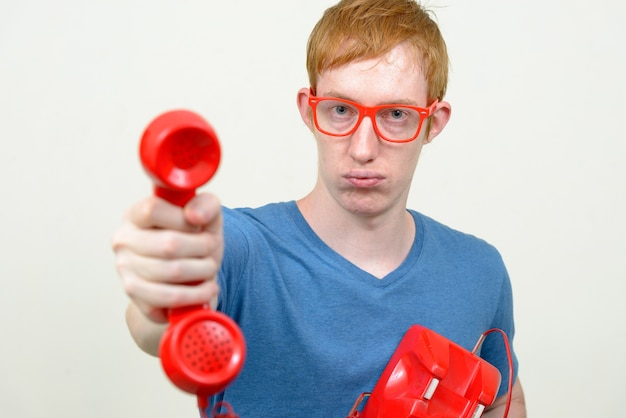Close up of nerd man with red hair wearing eyeglasses isolated