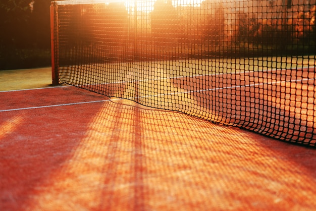 Close up of net on tennis court. picture taken in the morning at summer.