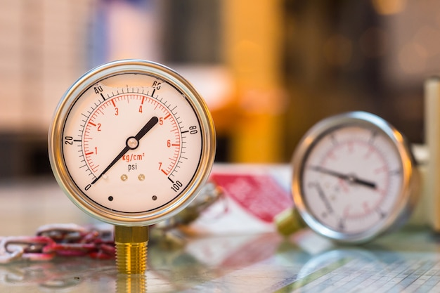 Close-up of new set of pressure gauge on glass table preparation maintenance