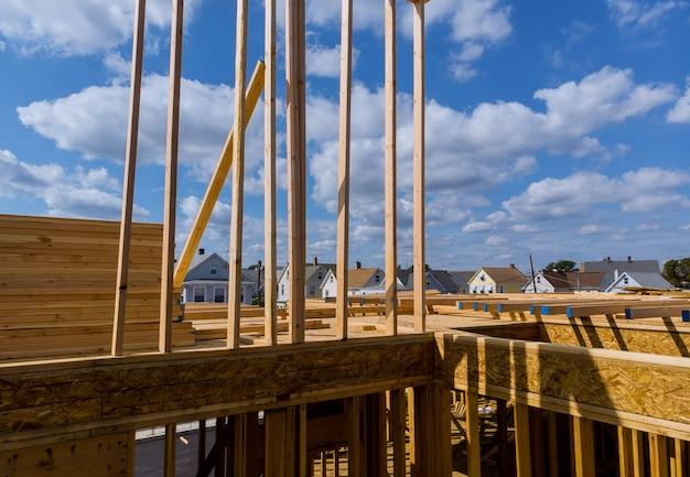 Close-up new stick built home under construction under blue sky framing structure wood fra