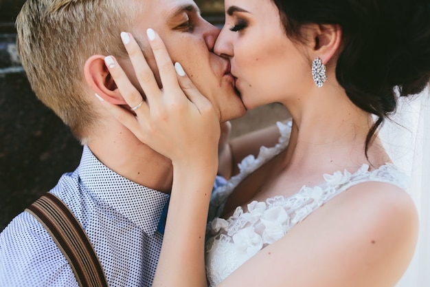 Close-up of newlyweds kissing passionately
