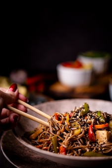 Close-up of noodles in bowl with vegetables