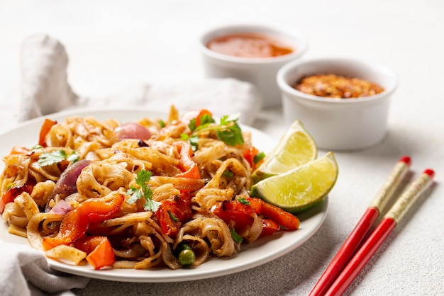 Close-up noodles with vegetables and chopsticks