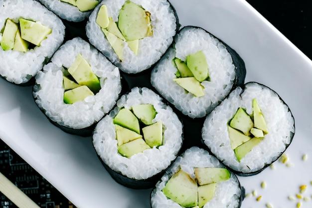 Close up of nori sushi rolls with avocado