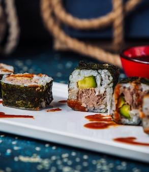 Close up of nori sushi rolls with tuna and cucumber