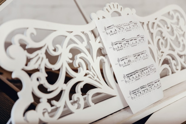 Close-up of the notes are on the piano