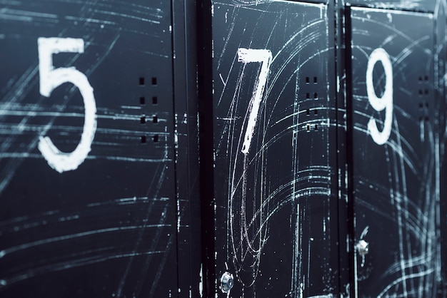 Close-up of numbered lockers in gym