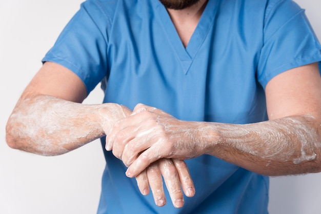 Close-up nurse disinfecting hands