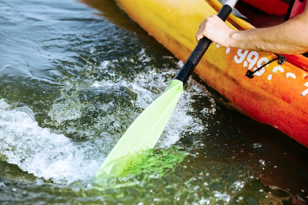 Close-up of oar paddle moving water