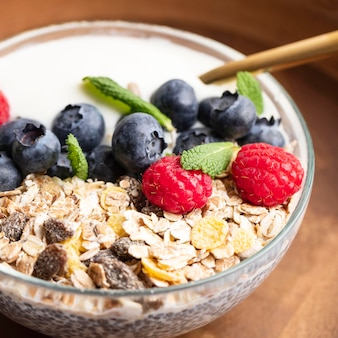 Close-up of oatmeal bowl with raspberries and blueberries