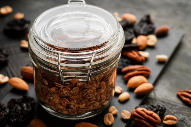 Close up oats jar with nuts mix and dates