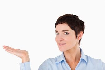 Close up of a businesswoman showing a copy space