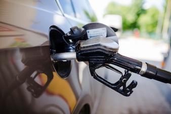 Close-up of a car refueling at petrol station