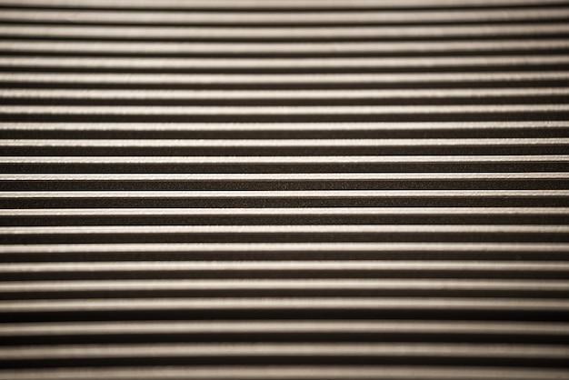 未確認の工場設備の波形金属表面の拡大図。洗練された設備と最新技術のコンセプト。軍事機器の生産の概念