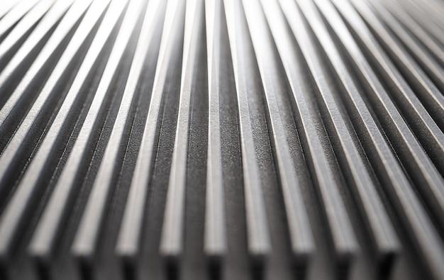未確認の産業機器の波形金属表面の拡大図。洗練された設備と最新技術のコンセプト。