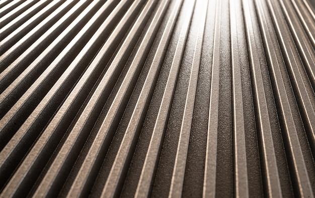 未確認の軍事機器の波形の金属表面の拡大図。洗練された設備と最新技術のコンセプト。家電製造コンセプト