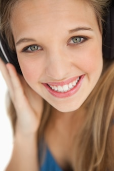 Close-up of a cute young blonde wearing headphones