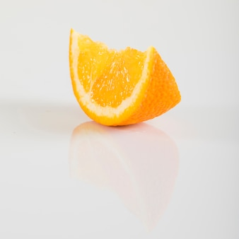 Close-up of a juicy orange fruit on white backdrop