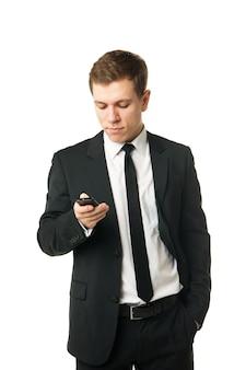 흰색 배경에 고립 된 전화에 웃는 사업가 닫습니다