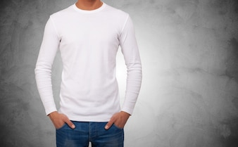 Close-up of a man wearing a white t-shirt with long sleeves