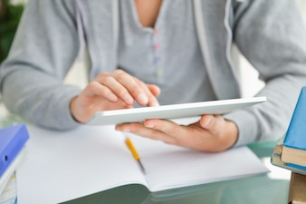Close-up of a student using a touch pad