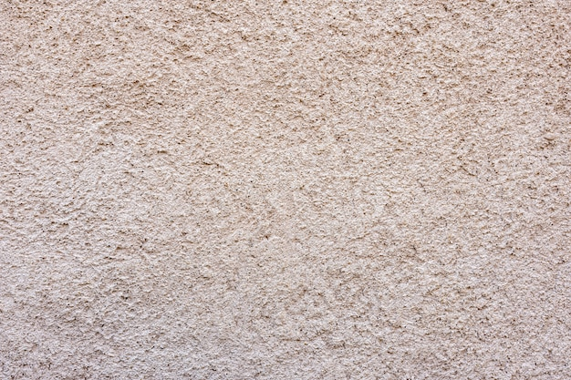 Крупный фрагмент текстуры декоративной штукатурки на стене здания