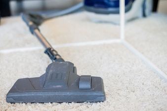 Close-up of a vacuum cleaner on carpet