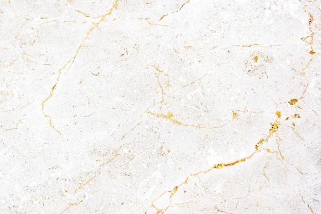 Заделывают белой мраморной текстурированной стены