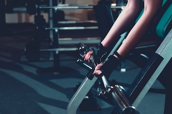 Close-up of a woman's hand doing workout in gym