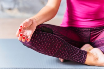 Close-up of a woman sits in lotus position
