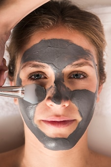 Close-up of a woman with face mask on her face