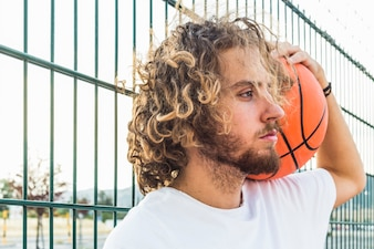 Close-up of a young man with basketball