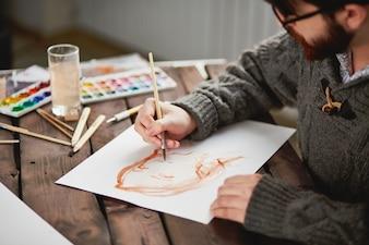 Close-up of an artist using a brush