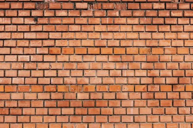 オレンジ色のレンガの壁のクローズアップ