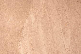 Close up of an orange rough wall texture