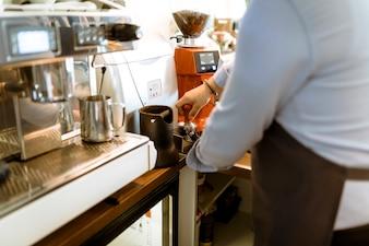 Close up of barman making coffee
