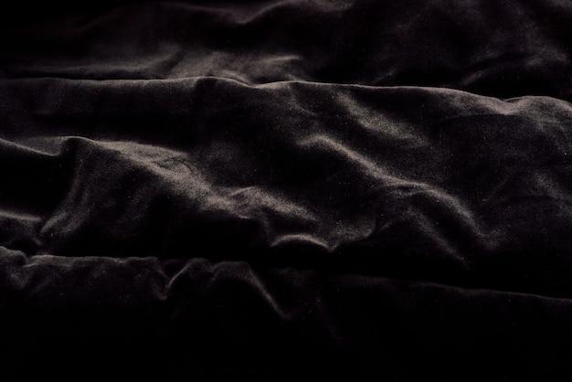 Закройте красивый черный бархат текстуры фона.